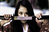 Girl with a katana — Stock Photo
