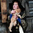 Witch with a red cat - Stock Photo