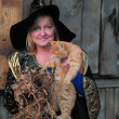 Stock Photo: Witch with a red cat