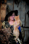 Witch with a red cat — Stock Photo