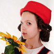 Girl in red hat with sunflowers in their hands — Stock Photo