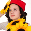 Girl in red hat with sunflowers in their hands — Stock Photo #5048994