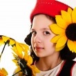 Girl in red hat with sunflowers in their hands — Stock Photo #5049001