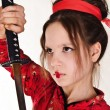 A girl handling a long samurai sword — Stock Photo