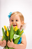 Girl with bunch of tulips — Stockfoto