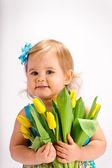 Girl with bunch of tulips — Stock Photo