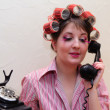 Housewife with curlers — Stock Photo
