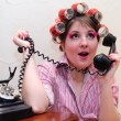 Housewife with curlers - Stock Photo