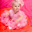Baby girl wearing pettiskirt tutu and pearls crawling — Stock Photo #5147427