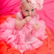 Baby girl wearing pettiskirt tutu and pearls crawling — Stock Photo