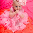 Baby girl wearing pettiskirt tutu and pearls crawling — Stock Photo #5147434