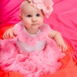 Baby girl wearing pettiskirt tutu and pearls crawling — Stock Photo #5147438
