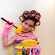A young housewife with brushes — Stock Photo #5215467