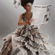 Girl in the newspaper — Stock Photo
