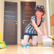 Stock Photo: Housewife washing floors