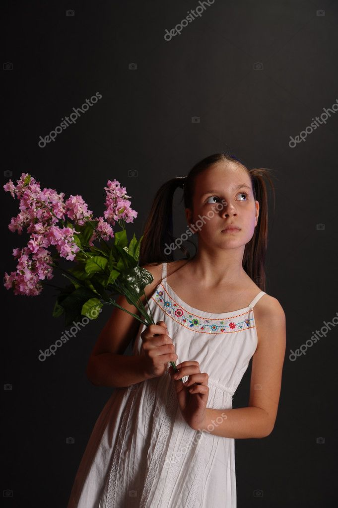 Girl with a bouquet of lilacs — Stock Photo #5285977