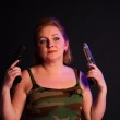 Woman with two guns — Stock Photo #5338357