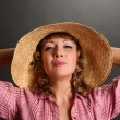 Portrait of a cute young woman wearing a straw hat — Stock Photo #5338821