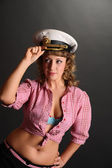 Beautiful woman in a captains hat — Stock Photo