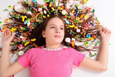 The beautiful girl with sweets in hair — Stock Photo