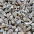 Pile of natural gray stone bricks closeup — Stock Photo