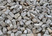 Pile of natural gray stone bricks closeup — Stock Photo