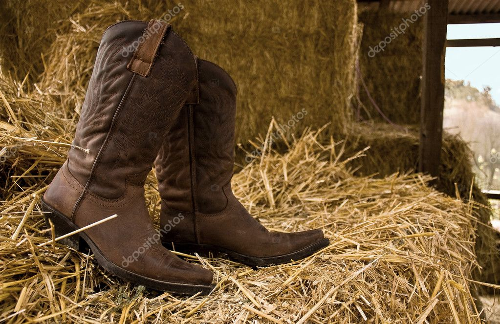 Boots and hay  Stock Photo #4259157
