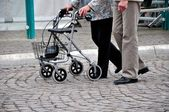 Seniors with wheeled walker — Stock Photo