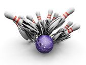 Bowling ball smashing into pins — Stock Photo