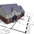 House on plans — Stock Photo #4380785