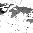 3D render of a jigsaw puzzle with a world map with final piece just added - Stock Photo