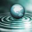 Globe on water ripples — Stok fotoğraf