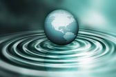 Globe on water ripples — Stock Photo