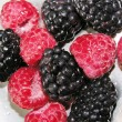 Raspberries and blackberries - Stock Photo