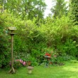Birdhouse in garden - Stock Photo