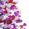 Stock Photo: Metallic hearts confetti