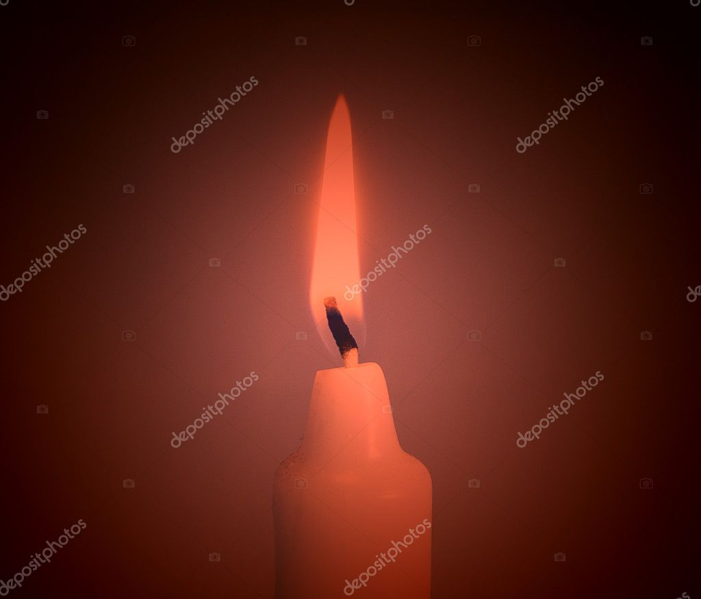 A single burning red candle  — Foto Stock #4391989