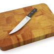Knife on chopping board - Stock Photo