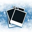 Polaroids on snowflake background — Stockfoto