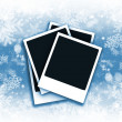 Polaroids on snowflake background — Stock Photo #4408944