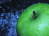Apple with moisture droplets — Stock Photo