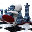 Man playing chess moving a pawn - Stock Photo
