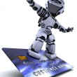 Robot surfing on credit card — Stock Photo