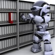Robot filing documents - Stock Photo
