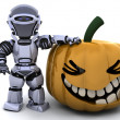 Robot with jack o lantern pumpkin — Stock Photo #5039839