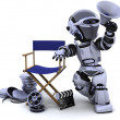Robot with megaphone and directors chair — Stock Photo