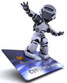 Robot surfing on credit card — Stok fotoğraf