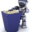 Robot with a box of popcorn - Stock Photo