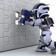 Royalty-Free Stock Photo: Robot with the final piece of the puzzle