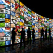 Looking at wall of screens — Stockfoto